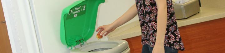 Student placing food waste in a food waste bin