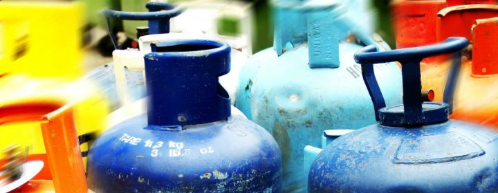 Pile of empty gas cylinders
