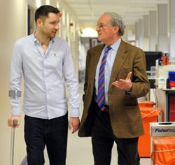 Gordon Aikman visits research labs with Donald MacDonald
