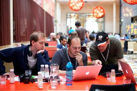 Three developers at a code sprint, sitting at a table.