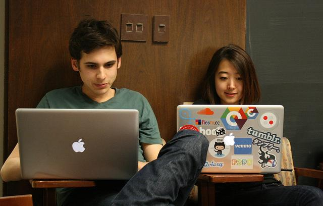 Photo of two students using laptops