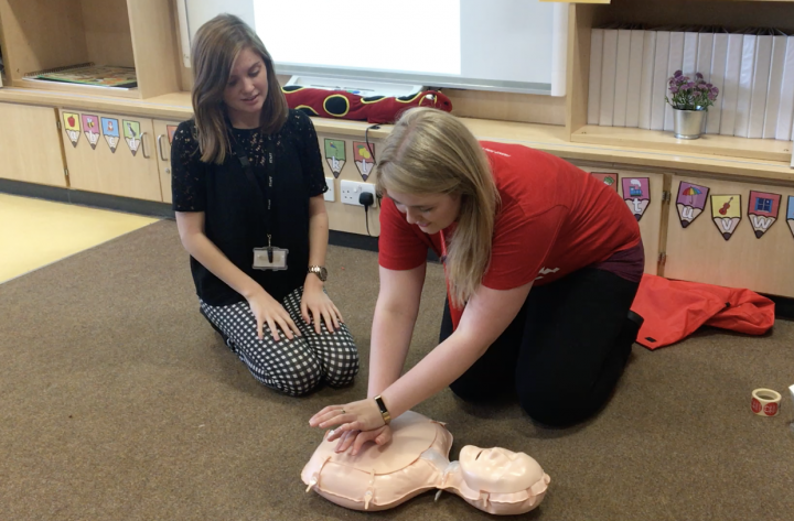 Hannah Costello teaching CPR in a local school