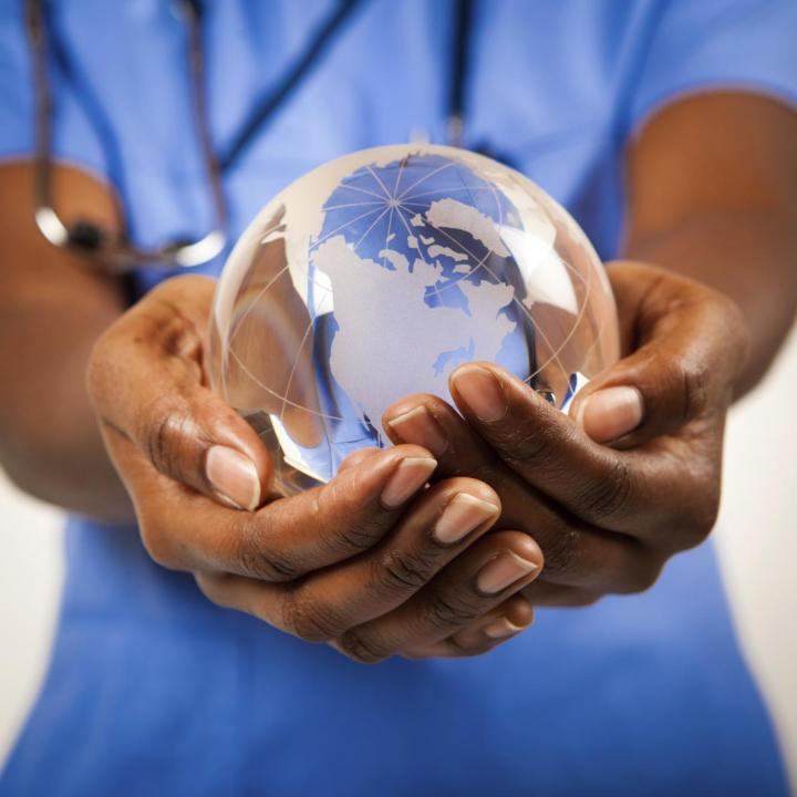 Doctor holding glass globe