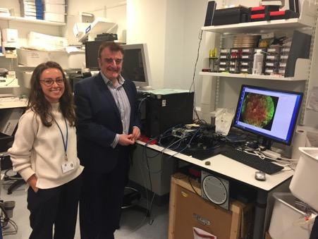 Tommy Sheppard and Helen Parker stand in a Proteus lab