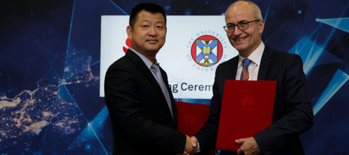 Peter Zhou and Charlie Jeffery agree a new research partnership between the University and Huawei credit Zhaohui Zhang