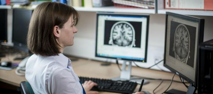 Woman looking at a brain on a screen
