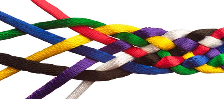 Photo of coloured threads intertwining