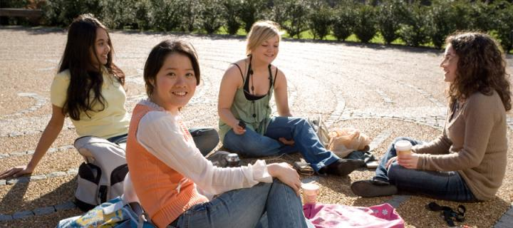 International students relaxing in the George Square labyrinth