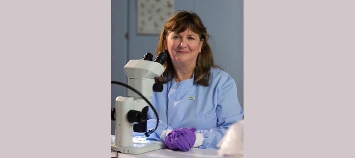 Lorna Dawson at the microscope