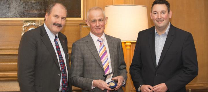 Malcolm Dunlop holding the Evans Forrest Medal