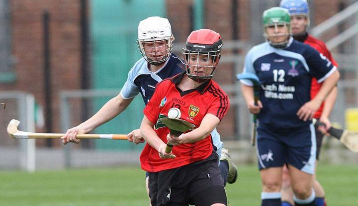 Photograph of women playing shinty