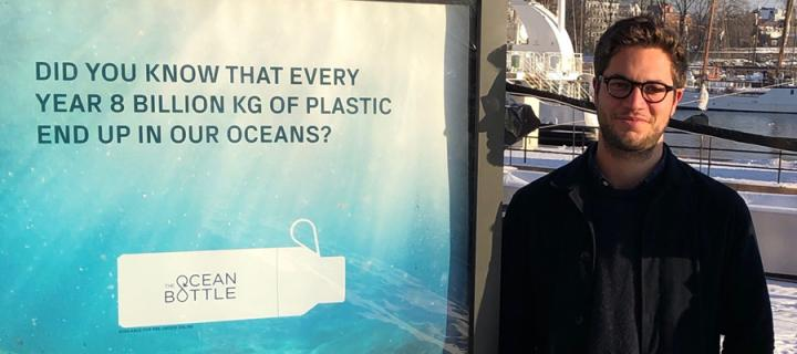 Nick Doman next to an advert for Ocean Bottle