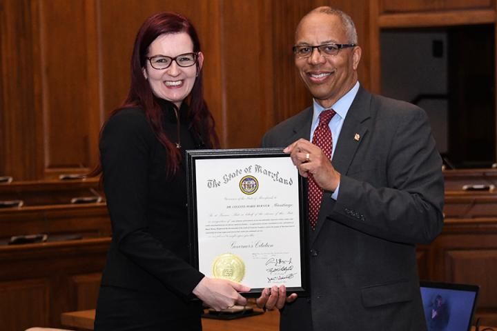 Photo of Celeste receiving a citation