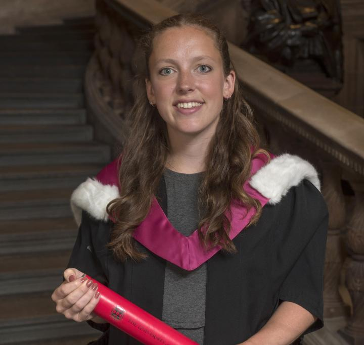 Current student Izzie Dighero accepting a degree on behalf of the Edinburgh Seven.