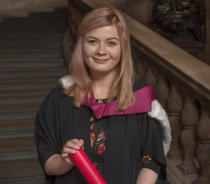 Current student Caitlyn Taylor accepting a degree on behalf of the Edinburgh Seven.