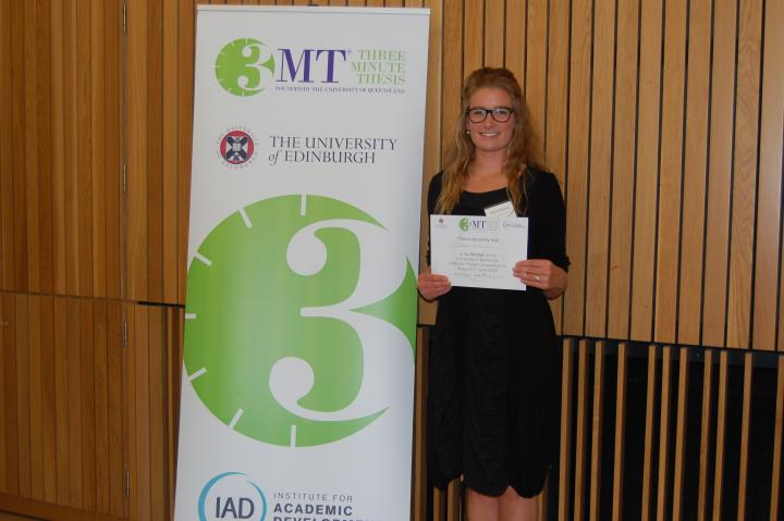 Phoebe Kirkwood receiving her prize for the three minute thesis competition