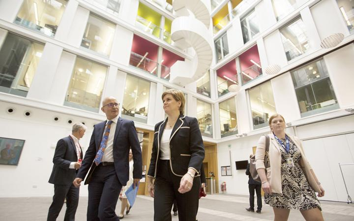 Prof Charlie Jeffery and First Minister Nicola Sturgeon walk through the Informatics Forum