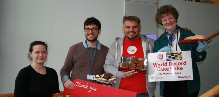 Bake-off star Glen Cosby and the organisers of the QMRI bake sale