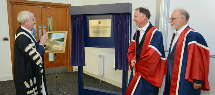 Principal unveils a plaque dedicated to the Robert O Curle Charitable Trust