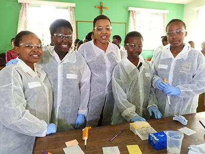 High school girls conducted the Rabies Lab experiment.