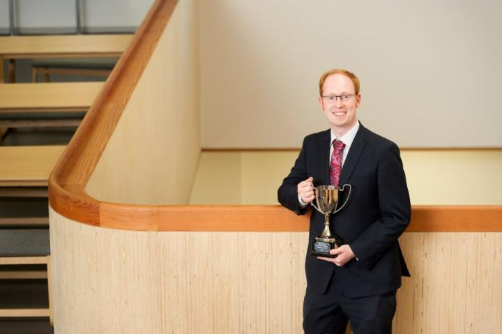 Sandy holding the University of Edinburgh Innovation Cup