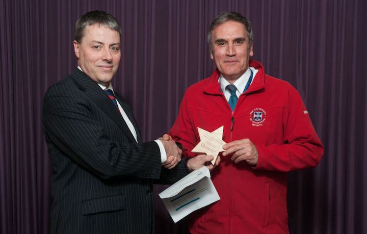 Frank Henzell picks up a Special Award for the Security team from Hugh Edmiston