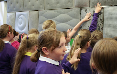 Primary school pupils taking part in a concrete workshop
