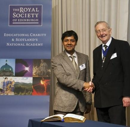 Professor Vijayakumar FRSE photographed (on the left) in 2013 with the then-RSE President Sir John Arbuthnott