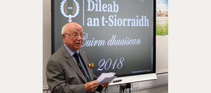 Sheriff Mackenzie at a prize-giving event for his charity Dileab an t-Siorraidh.