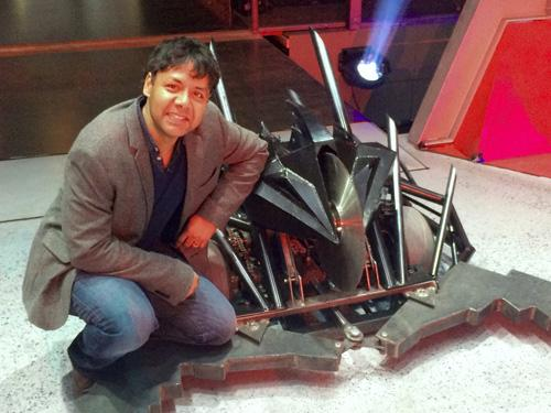 Sethu Vijayakumar with a house robot from Robot Wars. Credit: Mentorn Scotland