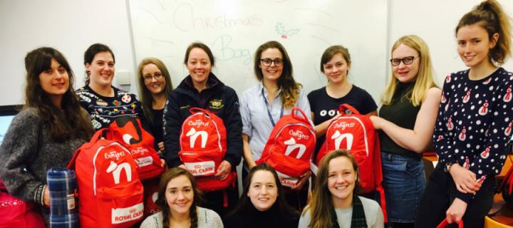 Veterinary students with donated backpacks containing pet supplies for homeless pet owners