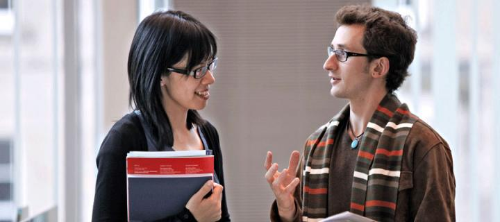 Photo of a student talking to Careers Service staff