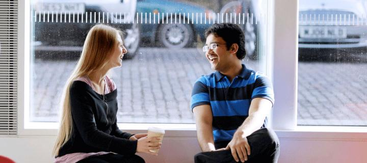Photo of students chatting in the Business School cafe