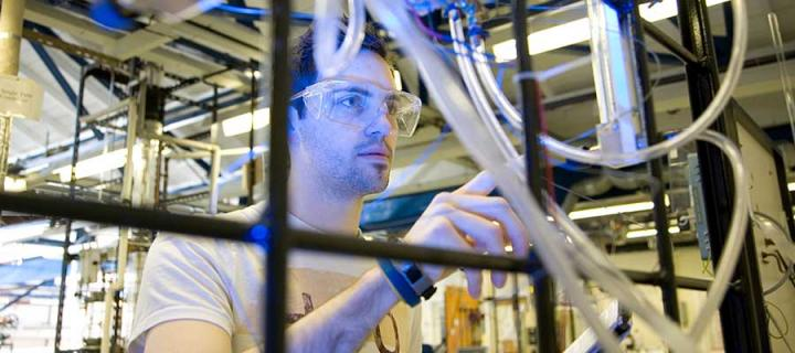 Photo of a student researching in lab
