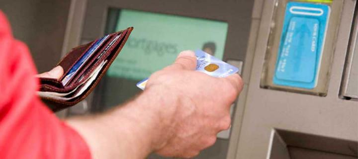 Student getting money out of ATM
