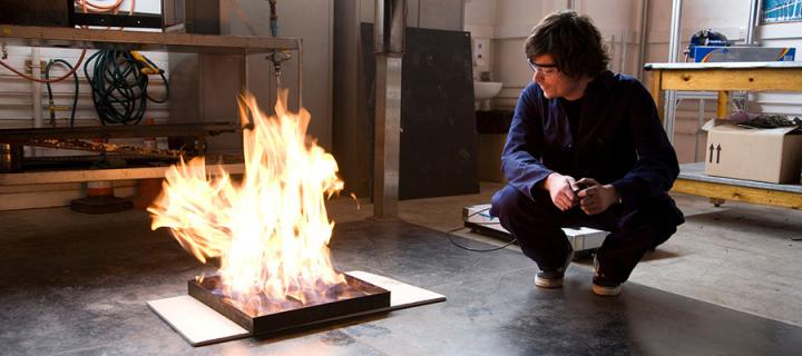 Student conducting a fires safety engineering experiment