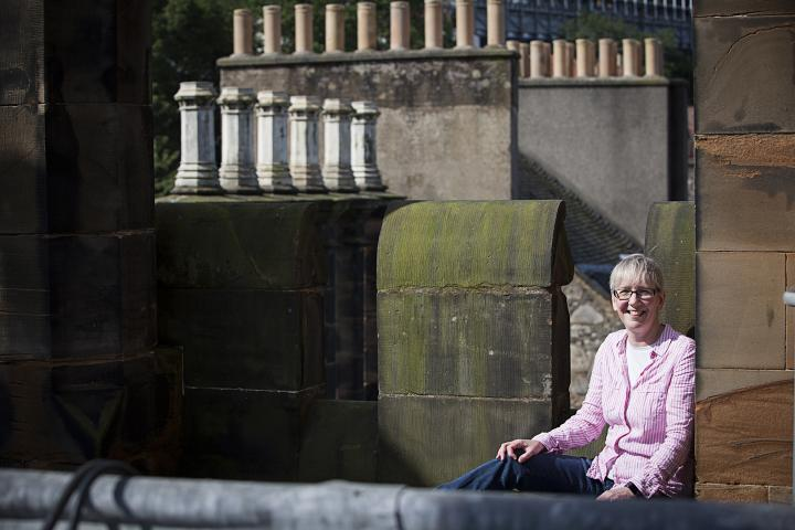 Susan Leven sat on the roof of New College