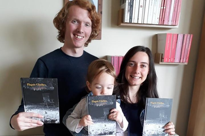 Photo of Taproot Press founders with books