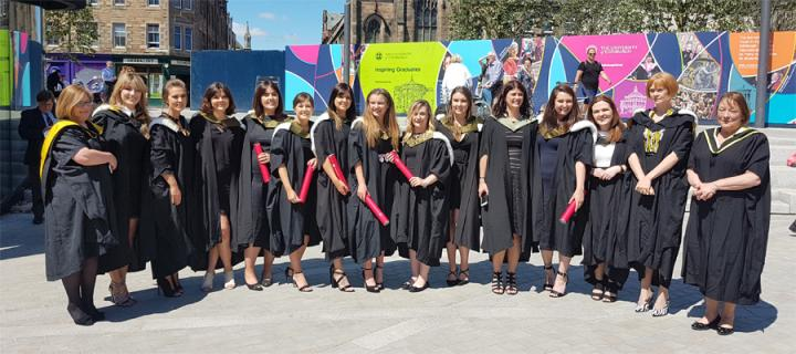 BSc (Hons) Oral Health Sciences graduation students with tutors