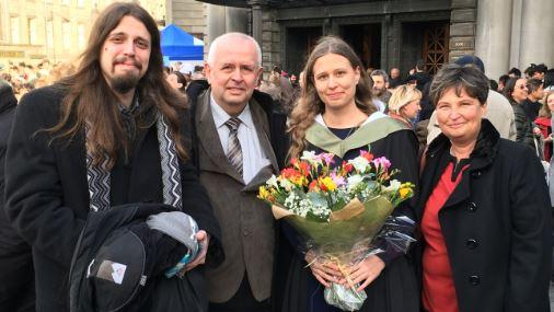 Graduate Soňa Galovičová (holding flowers) with brother Roman Galovič, dad Miroslav Galovič and mother Iveta Galovičová.