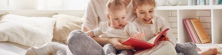 Two children reading books