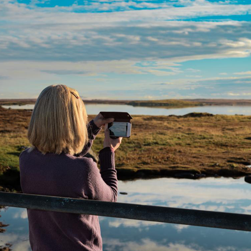 Woman taking picture in Scottish Highlands