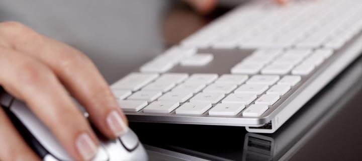 Hands on Apple keyboard and mouse
