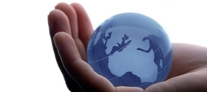 Globe cupped in palm of hand
