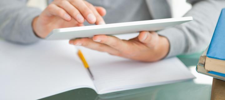 Hands using tablet computer
