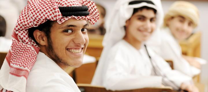 Group of Arabic students with eastern traditional clothes in classroom