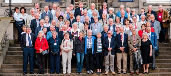 Class of 1966 group photo outside the Playfair Library