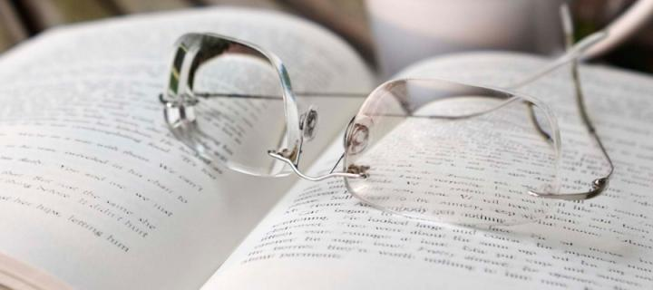 Glasses resting on book