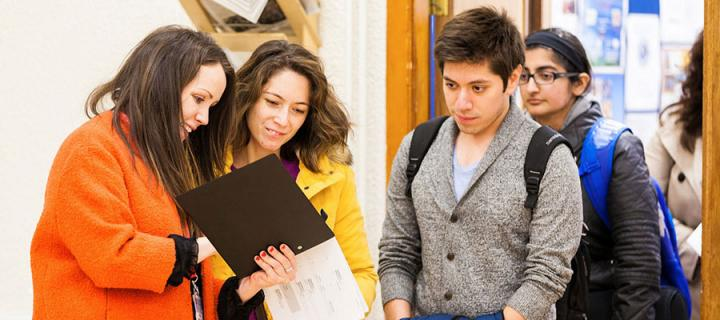 Students looking at a timetable