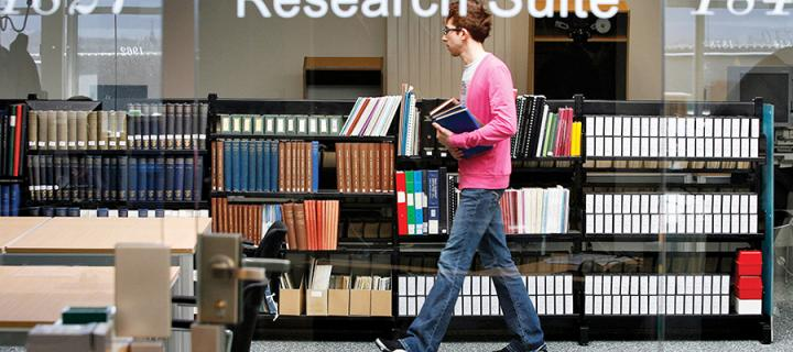 Student walking in the library